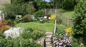 A garden outside Budleigh Farm Cottages