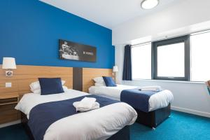 A bed or beds in a room at Lilleshall National Sports & Conferencing Centre