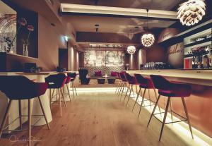 Ein Restaurant oder anderes Speiselokal in der Unterkunft Stadthotel Gürtler