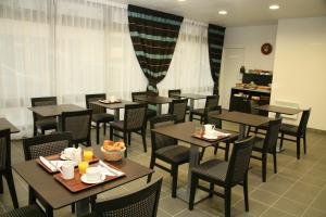 Restaurant ou autre lieu de restauration dans l'établissement Néméa Appart hotel Nancy Home Suite