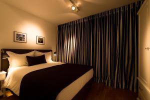 Een kamer bij Grand Place The Looks Apartment