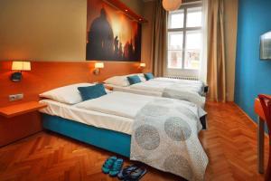Una habitación en Hotel Adler