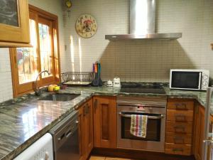 Una cocina o zona de cocina en La Casita del Río