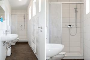 Ein Badezimmer in der Unterkunft Apartmenthaus Eldena