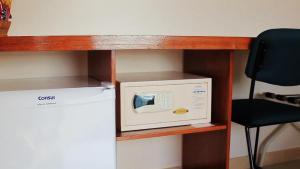 A kitchen or kitchenette at Pousada Canto da Baleia