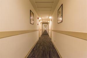 Двухъярусная кровать или двухъярусные кровати в номере Jinjiang Inn Changji Administration Center