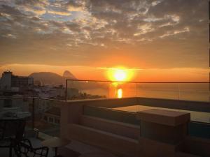 A balcony or terrace at Ritz Copacabana Boutique Hotel