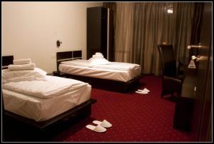 Un pat sau paturi într-o cameră la Vila La Mer