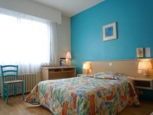 Un ou plusieurs lits dans un hébergement de l'établissement Le Crystal Hotel
