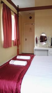 A bed or beds in a room at Barley Mow Hotel