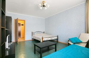 A bed or beds in a room at DearHome Trubetskaya