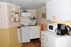 A kitchen or kitchenette at Åsens By