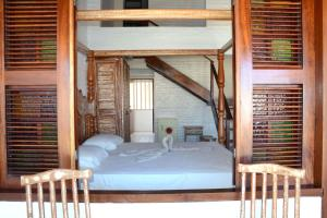 A bed or beds in a room at Pousada Lua Vermelha