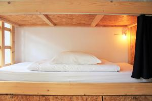 A bed or beds in a room at Lookout Lisbon Hostel
