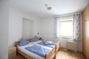 Ein Bett oder Betten in einem Zimmer der Unterkunft Berghotel Rudolfshütte