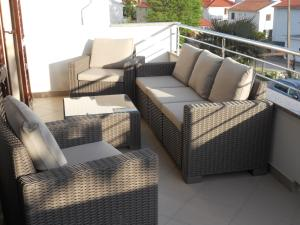 A seating area at Apartments Mihalić