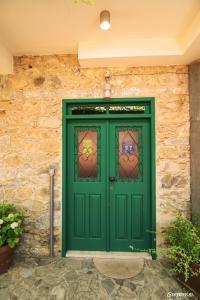 The facade or entrance of Anastou's Traditional House