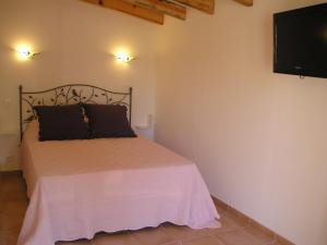 A bed or beds in a room at E Stelle di A Bella Vista