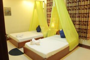 Una habitación en Golden Noura Villa-Pub & Restaurant