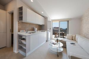 A kitchen or kitchenette at Trend Suites