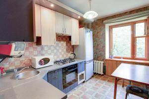 A kitchen or kitchenette at Щёлковские квартиры - Советский 5А