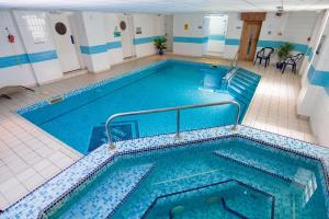 The swimming pool at or near Trouville Hotel - OCEANA COLLECTION