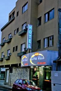 The facade or entrance of Alpha Ville Hotel