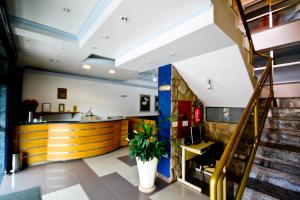 The lobby or reception area at Alpha Ville Hotel