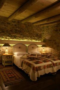 Ένα ή περισσότερα κρεβάτια σε δωμάτιο στο Argyriou Wine Tasting Guest House