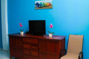 A television and/or entertainment center at Sabas Beach Resort