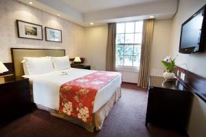 Um quarto em Hotel Vila Inglesa
