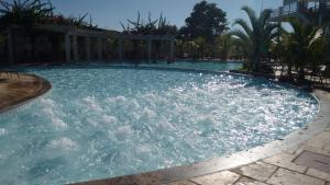 The swimming pool at or near Apartamento Lacqua Diroma