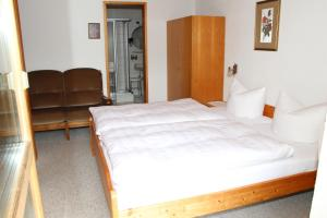 Ein Bett oder Betten in einem Zimmer der Unterkunft Haus Wijnands