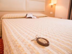 A bed or beds in a room at Hotel Regina