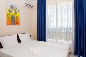Кровать или кровати в номере Mars Apartments in Tryavna Beach Complex