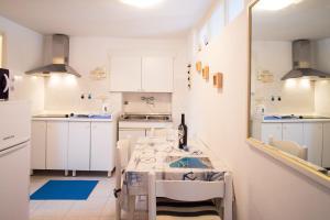 A kitchen or kitchenette at Apartmens Snježana