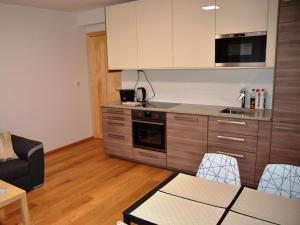 Kuchyň nebo kuchyňský kout v ubytování GoToPec Apartment