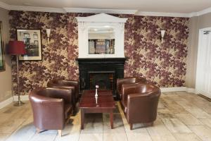 The lounge or bar area at Munster Arms Hotel