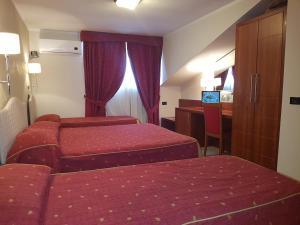 Letto o letti in una camera di Pisani Hotel