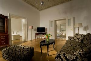 A television and/or entertainment center at Antiq Palace - Small Luxury Hotels Of The World