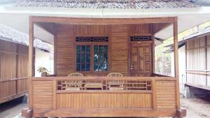 A porch or other outdoor area at Jonaths Cottage Bunaken
