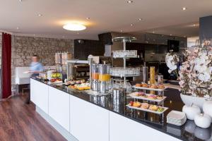 Ein Restaurant oder anderes Speiselokal in der Unterkunft Hotel Amaris