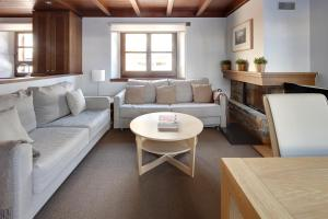 A seating area at Val de Ruda 18 by FeelFree Rentals
