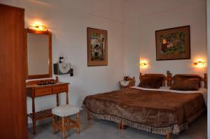 Ein Bett oder Betten in einem Zimmer der Unterkunft Villa Flouri