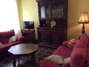 The lounge or bar area at La Abuela Maye y Me