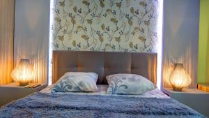A bed or beds in a room at Guest House Lora