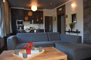 A seating area at Suite & City Apartments