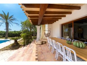 A porch or other outdoor area at La Orilla