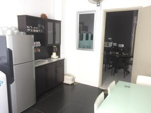 A kitchen or kitchenette at 1-World Condo - Tok Bali Place