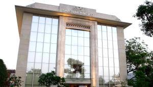 The facade or entrance of Muse Sarovar Portico Nehru Place